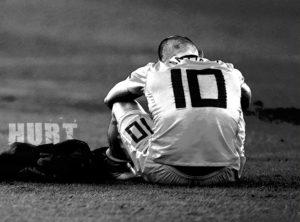 Resultados. Deportista sentado en el suelo.